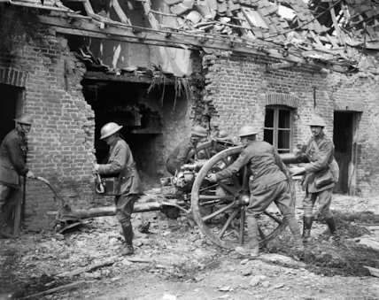 Gunners of the Royal Field Artillery manning an 18 pounder gun in the village of Saint-Floris, 2 May 1918.