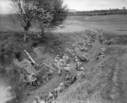 Troops of the American 30th Infantry Division awaiting orders in a sunken road, Battle of Cambrai, 8 October 1918.