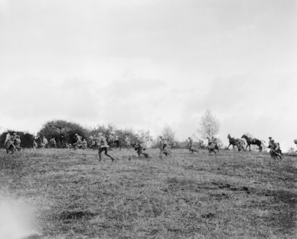 Troops of the American 30th Infantry Division moving forward during their advance on the village of Premont, 8 October 1918.