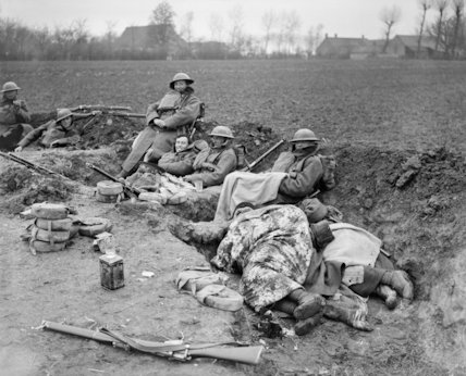 Men of the British 51st Division in a hastily dug trench in a ploughed field near Locon.