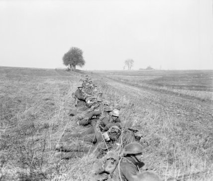 British infantry of the 20th Division in a support position along the edge of a road near Nesle, 24 March 1918.