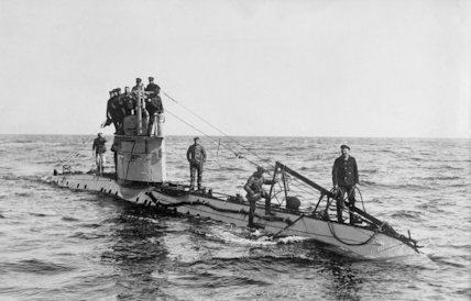 Crew on the deck of a German U-boat submarine at sea.