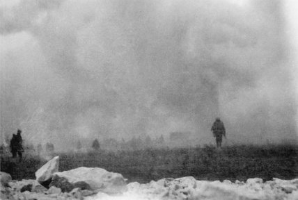 British troops advance to the attack through a cloud of poison gas as viewed from the trench which they have just left.
