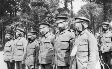Men of 1/5 Kings Own Royal Regiment wearing the first rudamentary gasmasks with which they were issued on the Western Front, 1915.