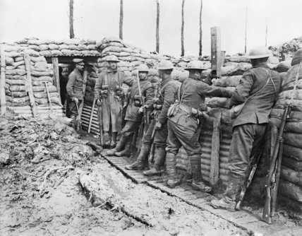 Infantry of the 1st Canadian Division having a meal in the trenches at Ploegsteert, 29th March 1916