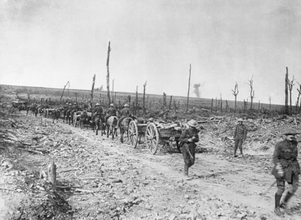 Ammunition limbers of 35th Field Battery, Royal Field Artillery, passing a corner of the shattered Delville Wood, Somme, 17th September 1916.