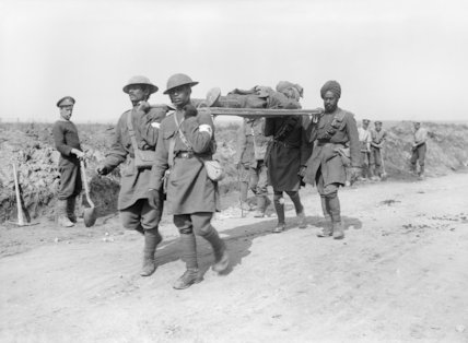 Indian Army stretcher-bearers bringing in a wounded officer near Ginchy, Somme, 14 September 1916.