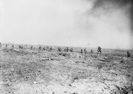 Supporting infantry walk forward up the slope into the bombardment, The Battle of Ginchy, Somme, 9 September 1916.