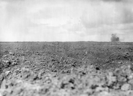 No Man's Land near Mouquet Farm, Somme, September 1916. A British shell can be seen bursting on German trenches.
