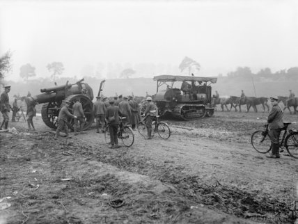 An 8-inch howitzer being towed into position by a Holt caterpillar tractor near Albert, Somme, September, 1916.