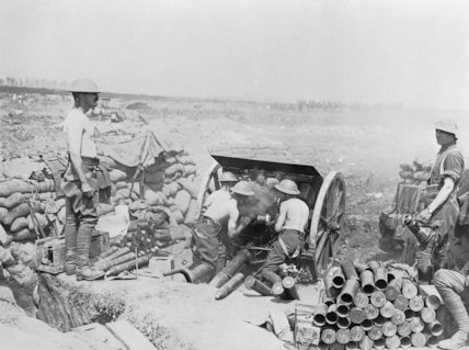 18 pounder gun, its crew stripped to the waist in the sunshine, putting over curtain fire or barrage. Carnoy Valley, Montauban, 30 July 1916.