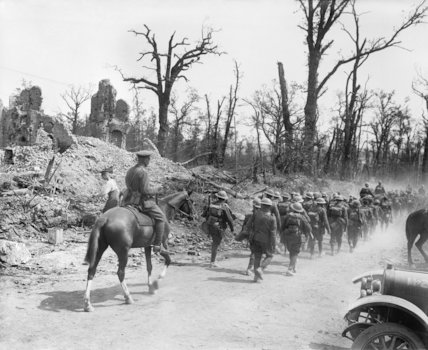 Battle of Pozieres Ridge. British troops are marching through the ruins of Fricourt, Somme, August 1916.
