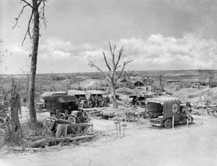 A dressing station set up near Fricourt during the Battle of Pozieres Ridge. The ambulance on the right bears the fern leaf insignia of the New Zealand division next to its cab door. Somme, August 1916.