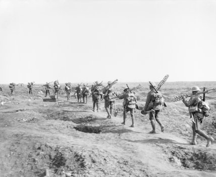 A wiring party carrying their implements going up to the front line near Ginchy. The Battle of Morval, Somme, 25 - 28 September.