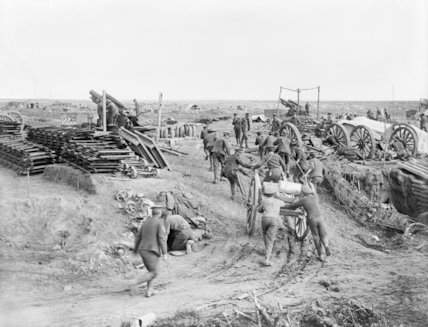 Troops of the Royal Garrison Artillery taking up shells by handcart to 9.2 inch howitzer battery. South of Bernafay Wood, Somme, October 1916.