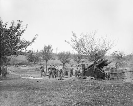 A 9.2 inch howitzer of the Royal Garrison Artillery in action. Just outside Albert, Somme, July 1916.