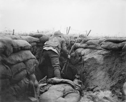 A Lancashire Fusilier sentry in a front line trench and British wire in
