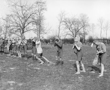The sports meeting held by the 1/7th Battalion, Black Watch at Bailleul-aux-Cornailles, 10 May 1917. Gas mask race.