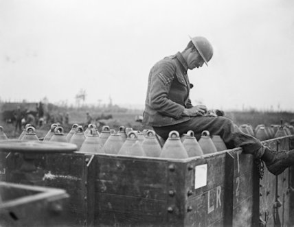 Corporal checking shells in a light railway truck. St. Eloi, 11 August 1917.