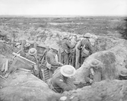 Infantry wearing bandoliers of ammunition in support trench at Wieltje, 19 August 1917.