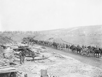 Royal Artillery ammunition column passing an Australian 9.2 inch howitzer battery. Fricourt, August 1916.