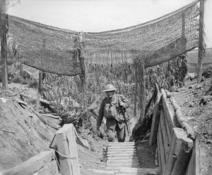 Soldier of the 20th Light Division in a communication trench with camouflage netting, Lens, 14 May 1918.