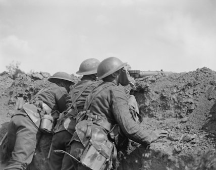 Lewis gunners of the 12th Battalion, Royal Scots, wearing box respirators during a gas attack on a front line trench, Meteren, 25 June 1918.