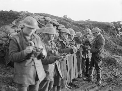 Men of the York and Lancs. Regiment on the 62nd Division front (Oppy-Gavrelle). An Officer inspecting small box gas respirators.