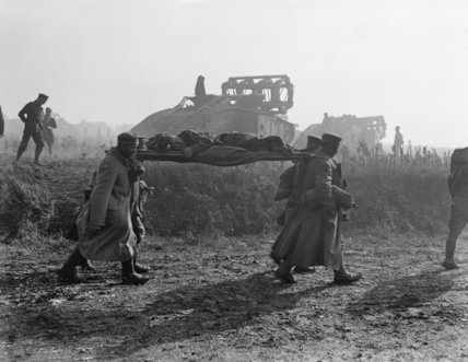 Prisoners bringing in wounded and Mark V Tanks advancing near Bellicourt, 29 September 1918. The Tanks are carrying