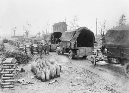 Lorries loading to take ammunition to forward dump.