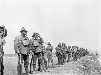 Men of a New Zealand Regiment wearing gas masks during musketry training, March 1918.