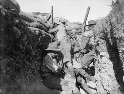 An Australian using a sniperscope and his spotter with an improvised periscope in a trench, Gallipoli, 1915.