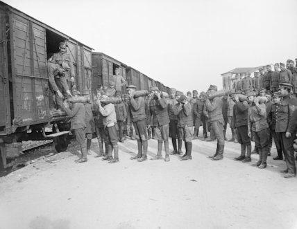 Austrian prisoners loading shells on to railway trucks at a railhead.