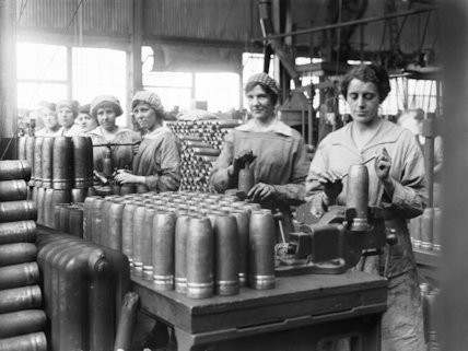 Women war workers tap shells at the Royal Shell Factory, Woolwich Arsenal.