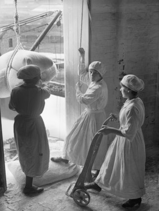 Women workers landing sacks of flour from a barge at the mills of Messrs. Rank & Sons, Birkenhead, September, 1918.