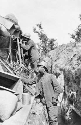 Italian soldiers wearing gas masks in front line trenches on Podgora Hill.