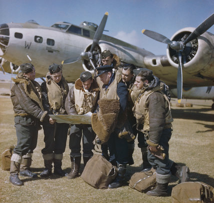 Publicity shot purporting to show the captain of a Boeing Fortress Mark II  holding a final conference with his crew before take off.