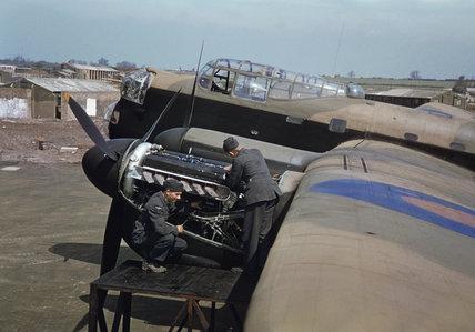 Mechanics work on the port engines of an Avro Lancaster