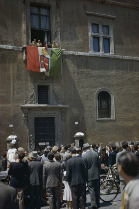 Allied troops on the flag draped balcony of Palazza Venezia