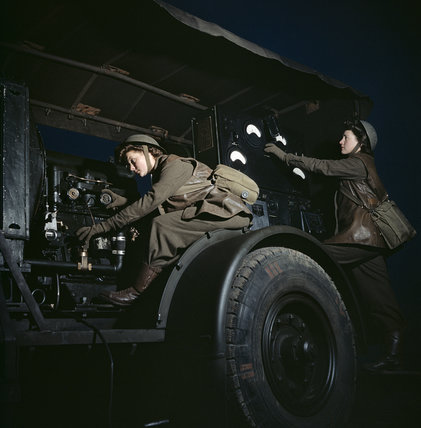 Two ATS girls operate a mobile power plant on an anti-aircraft gun site