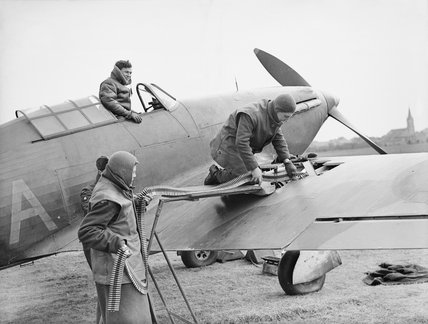 The Royal Air Force in France 1939 - 1940: A Hawker Hurricane fighter is loaded with ammunition before a mission.