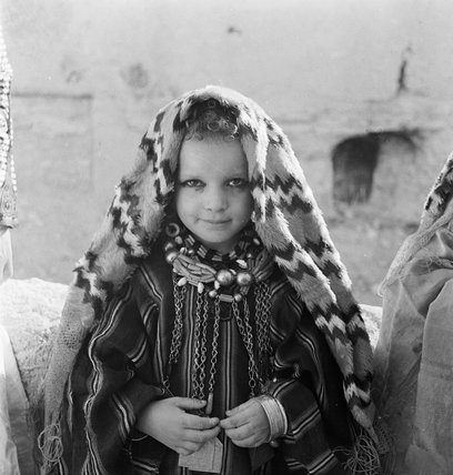 A young child in traditional dress at Siwa, Libya, 1942