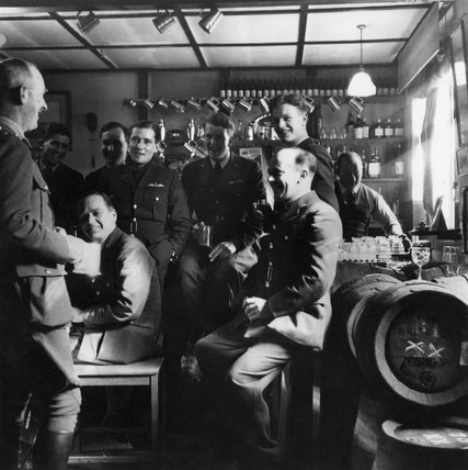 RAF fighter pilots in the mess bar, Britain, 1941 ...