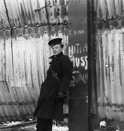 A British sailor on shore leave waits for transport away from the dockside,  Harwich, 1941