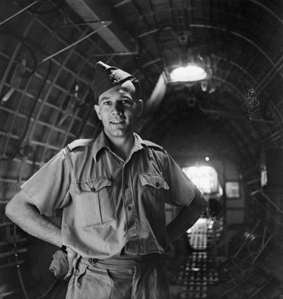 Alexandria :  No. 230 Squadron RAF Sunderland Flying Boat Station. Portrait of an airman standing inside a Sunderland.