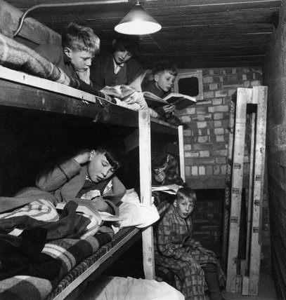 SCHOOLBOYS AT CHIGWELL SPEND NIGHTS IN UNDERGROUND SHELTER BUNKS