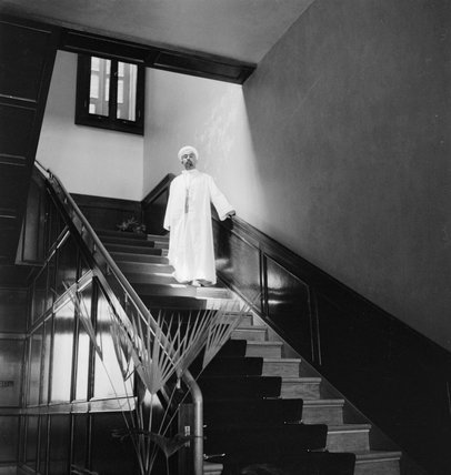 Emir Abdullah of Transjordan on a staircase in his palace in Amman, Transjordan, 1942