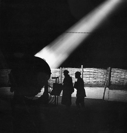 A Royal Artillery searchlight monitors the night sky at the height of the Blitz, London, 1940