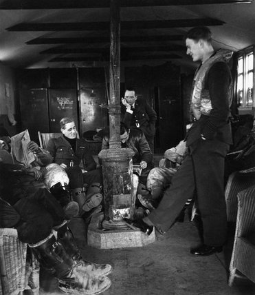 RAF fighter pilots relax between operations in their dispersal hut, Britain,1941