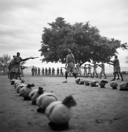 Having removed their turbans, Muslim and Hindhu Sikh police recruits are instructed in drill at a Frontier Constabulary training establishment, Nowshera,  Khyber Pakhtunkhwa Province, India, 1944